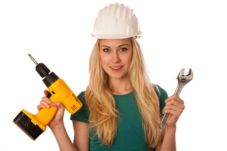 52285174 - woman with constructor helmet and tools happy to do tough work.